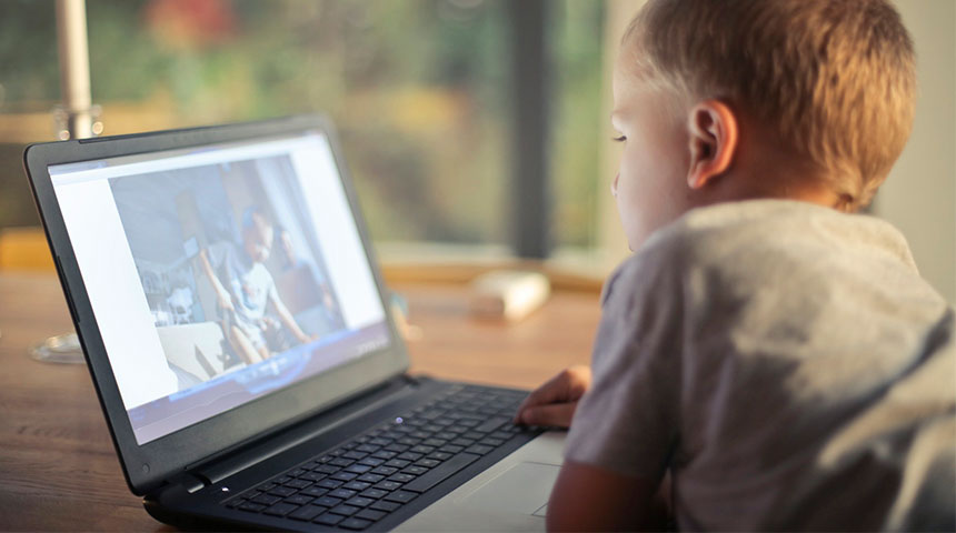 kid watching computer - The Effectiveness behind Educational Video games