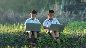 two kids laptop 300x167 - two-kids-laptop